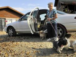 Mary Louise Mills brings her dogs to Shelley Bunkholt at Foxy's Pet Grooming in South Haven.