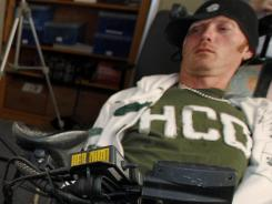 Tim Hemmes had a chip implanted on the surface of his brain that reads his intention to move his paralyzed arm and sends that instruction instead to an advanced bionic arm. The goal is to create mind-controlled prosthetics to restore some independence to the paralyzed.