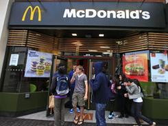 About 1,200 McDonald's restaurants in Britain will begin displaying the calorie count of each food and drink item on their wall-mounted menu boards this week, as part of a government-led program to fight obesity and promote healthier eating, the chain said Sunday. The British program is voluntary, and relies on partnering companies to fulfill their health pledges.