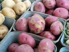 Steaming, boiling and baking, using no fat or just a little bit, is the most healthful way to prepare potatoes.