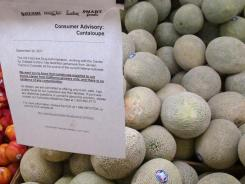 A consumer advisory about the safety of California cantaloupes hangs in a supermarket in Fresno, Calif.