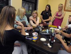 Roxanne Szal, third from left, leads a discussion with members of her Chi Omega sorority at the sorority house.