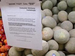 A consumer advisory about the safety of California cantaloupes hangs in a supermarket in Fresno, Calif., on Tuesday, Oct. 11, 2011.