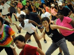 Hundreds of participants join popular Zumba instructors Leonardo Lins and Roberson Magalhaes, both from Brasil, for an hour long Zumba workout at the Franconia Fire Station on Beulah Street.