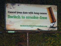 A  billboard by switchandquitowensboro.org stands along New Hartford Road in Owensboro.
