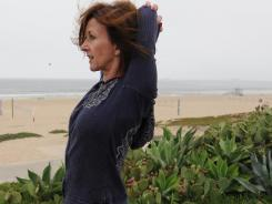 Mary Claire Orenic stretches during her walk in Manhattan Beach, Calif.