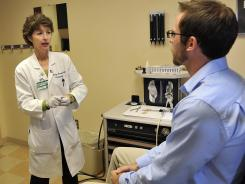 Medical Director Dr. Gaelyn Garrett, center, asks questions for patient at Vanderbilt Voice Center in Nashville, Tenn.