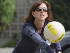 Mary Claire Orenic runs volleyball drills with he son Christopher in the driveway of the family's home. Christopher is a top high school volleyball player at Mira Costa High School.