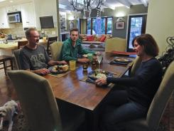 Mary Claire Orenic sits down for Sunday dinner with her family -- husband Chris, son Christopher and dog Steve McQueen.