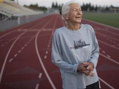 Joy Johnson walks at a local track in San Jose, California.