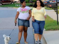 Stormy Bradley, right, and her daughter Maya, 14, walk their dog Bubbles in their neighborhood in Atlanta. Maya is part of an anti-obesity ad campaign in Georgia.
