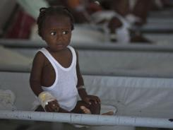 A girl receives treatment for cholera symptoms at a Doctors Without Borders, MSF, cholera clinic in Port-au-Prince, Haiti.