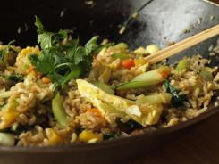 "Brown rice ""dressing"" gets a next-day makeover as fried rice, with bok choy, carrots, fresh herbs and shredded egg."