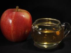 The FDA said it will examine whether its restrictions on the amount of arsenic allowed in apple juice are stringent enough.