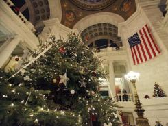 "The Rhode Island Statehouse hosted dueling tree lightings as Gov. Chafee and Republican State Rep. Doreen Costa battle over whether to call the official state spruce a ""holiday"" tree or a ""Christmas"" tree."