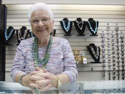 Maxine Bennett, 91, at a counter at her jewelry store in Dallas. Bennett is part of a growing number of people who continue working way past the usual retirement age.