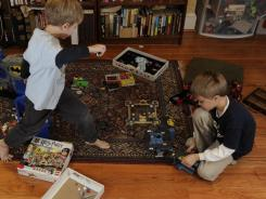 Sammy Snyder, 6, left, and his brother, Benji, 8, at their home in Philadelphia. Their father, Steve Snyder of The Franklin Institute, an interactive science museum, knows the value of play.