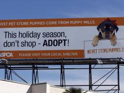 A billboard encouraging people to fight puppy mills by boycotting pet store puppy sales is seen atop a building in Los Angeles.