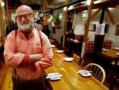 Ed Schoenfeld stands in his restaurant Red Farm in New York. RedFarm is a trendy Chinese restaurant full of quirks, like a menu featuring Pac-Man dumplings and pastrami egg rolls and a rustic decor.