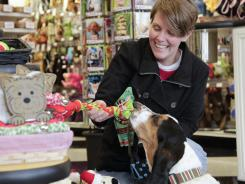 Stocking stuffers: Teacher Susan Sallee shops with her basset hound, Gerdi, during one of their routine visits to IncrediPet Select pet store in Lexington, Ky .