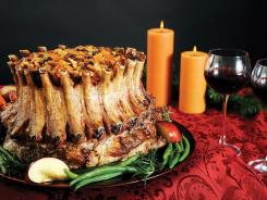 Crown Roast of Pork filled with a fruit stuffing makes a dramatic presentation on any holiday table. The four-pound roast shown serves 18-20.