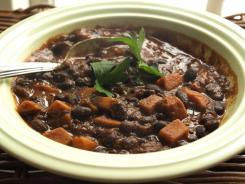 Brighten the darkest days by hanging out at the stove rather than at the mall. The menu: A pot of black bean chili, studded with sunset-colored sweet potatoes. It will take the chill off the weather, the edge off your mood, and Christmas Day, the sun is already setting a few minutes later.
