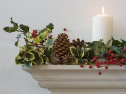 In a pinch:  Use pine cones, holly and candles  to decorate  a mantel.