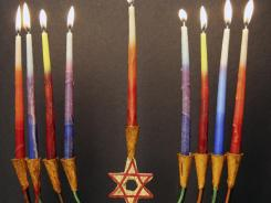 The center candle (candleholder) is generally taller than the other eight, flanking it four candles on either side; it is called the Shamash and its main duty is to light the other candles each night.