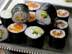 There are many varieties of sushi, but the most appropriate for a party like this is the maki roll.