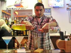 Yuma Amador practices mixing cocktails at the American Professional Bartender School in Villa Park, Ill.