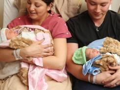 Jolene and John Anthony, hold their twins at Rapid City Regional Hospital in Rapid City, S.D.. Baby John was the first baby of the new year at the hospital while his sister Kylee was the last baby of 2011.