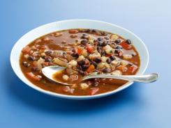 {96}Mine chili is chockfull of black beans and hominy, a combo that makes a wonderful meatless meal.