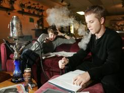 This file photo from 2005, shows a hookah lounge in Olympia, Wash.  Health officials and researchers say the ancient smoking method, may actually pose great health risks, including carbon-monoxide poisoning.