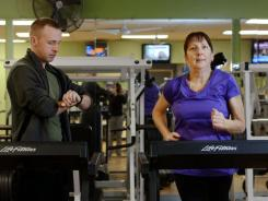 Elaine Jacobson, 56, works with personal trainer Bill Price at her gym in Rochester, N.Y. She has lost 135 pounds since June 2010.