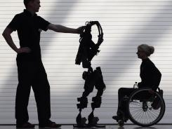 It straps around people so they can stand upright and walk with a walker. The device is propelled by electrical impulses and robotic sensors that help keep users upright and gently propel them forward, a step at a time.