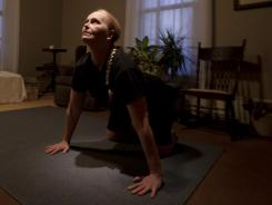 Kim Poer, 51, cleared out her living room to use as a yoga room at her home in Villa Rica, GA.