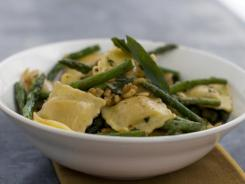 This photo shows ravioli with fried sage, asparagus and walnuts. The asparagus and walnuts pair perfectly with the sage and ghee in this recipe, but don iacute/>t hesitate to mix it up.