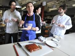 Jack Bishop, the Editorial Director of America's Test Kitchen, center, taste tests a turkey meatloaf with brown sugar and ketchup gravy. Also seen are, from left, Cook's Illustrated Associate Editors Andrew Janjigian, and Dan Souza, assistant test cook Celeste Rogers, and Cook's Illustrated Senior Editor Keith Dresser.