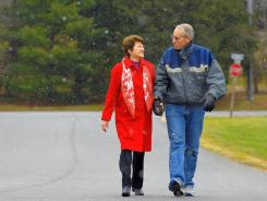 Carol and Bob Blackwell take a daily walk near their suburban Virginia home.