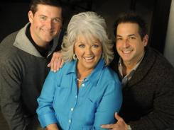 Paula Deen is announcing that she has type 2 diabetes. She is modifying some of her recipes with sons Bobby, right, and Jamie.