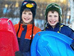 Grant Schlager, 11, left, is allergic to cold. Brother Nathan, 10, is not.
