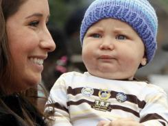 Bristol Palin holds her and Levi Johnston's son Tripp Johnston at the governor's picnic in Anchorage, Alaska.