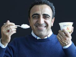 In this photo, Hamdi Ulukaya, CEO of Chobani Greek Yogurt, poses at the Chobani plant in South Edmeston, N.Y.