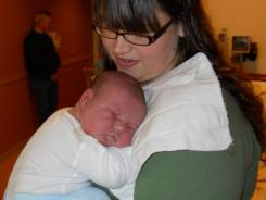 Kendall Stewardson holds her newborn son Asher, who was born Jan. 26, 2012, weighing 13 pounds, 13 ounces. He measured 23 1/2 inches.