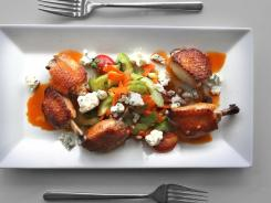 Chicken wings with celery heart and blue cheese salad can add a flair to your Super Bowl party.