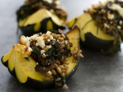 This farro and mushroom stuffed acorn squash is a one-dish meal that's rich in savory flavors thanks to a blend of meat, mushrooms and cheese.