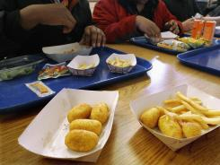 Illinois legislators are considering a ban on trans fats, blamed for contributing to soaring national childhood obesity rates, in foods served in school cafeterias and vending machines.