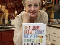 "Barbara Kafka, poses with her book ""The Intolerant Gourmet: Glorious Food without Gluten and Lactose,"" in her kitchen in New York."