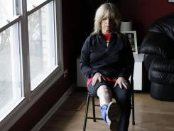 Donna Brent, 63, works out her leg at her home in Deerfield, Ill. When pain started getting in the way of some of her sports, she gave in to her doctor's advice and had a knee replacement operation last June on her right knee.