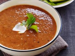 Roasted tomato and black bean soup with avocado mango salad by Ellie Krieger.